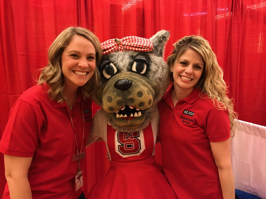 Picture of two staff members and Mrs. Wuf
